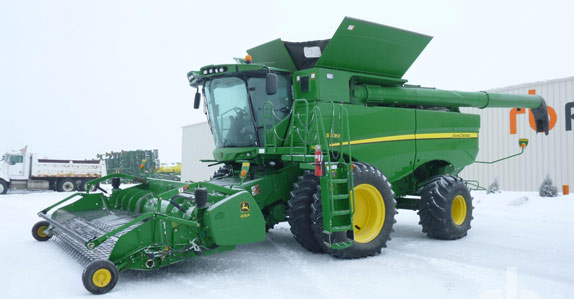 2012 John Deere S690 Combine http://www.rbauction.com/blog/five-big-ticket-agriculture-items-of-the-month-march-2013