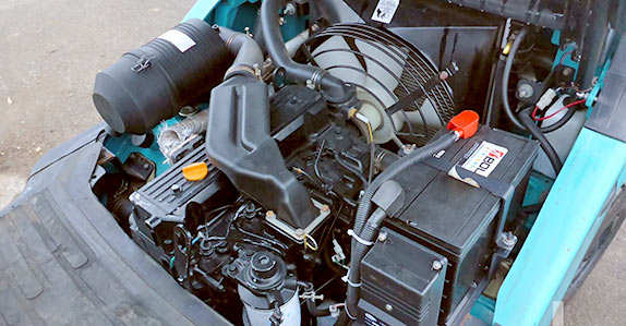 Take your time and inspect the engine compartment as well before buying a used forklift
