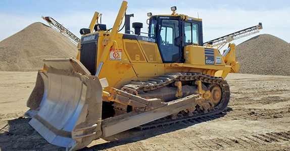 Komatsu 155AX dozer sold at a Ritchie Bros. unreserved public equipment and truck auction.