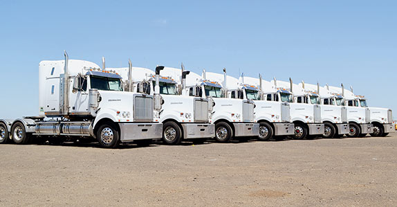 A line-up of 2013 Western Star 4900FX and 4900FXT in Geelong.