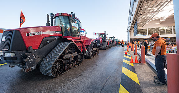 Belted ag tractors being sold at a Ritchie Bros. auction