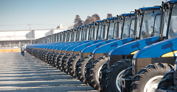 Farm tractors lined up at a Ritchie Bros. auction