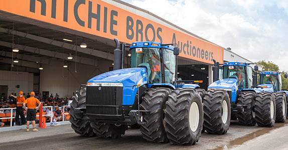 Farm tractors being sold at a Ritchie Bros. auction in Australia