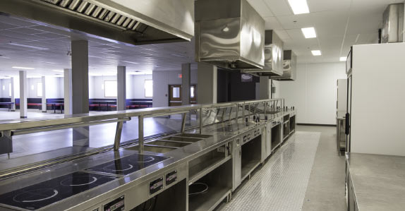 The fully-equipped, professional-grade kitchen in the work camp for sale at Ritchie Bros.