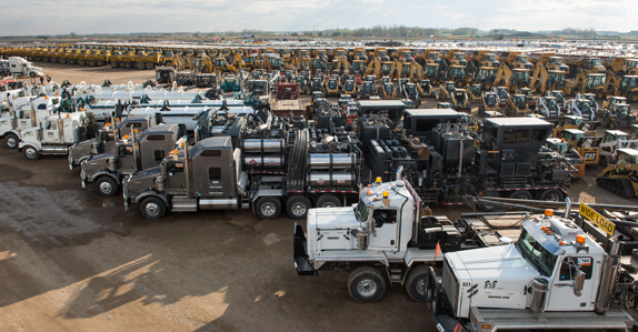 Equipment and trucks ready to sell at Ritchie Bros. Edmonton auction in April 2016.