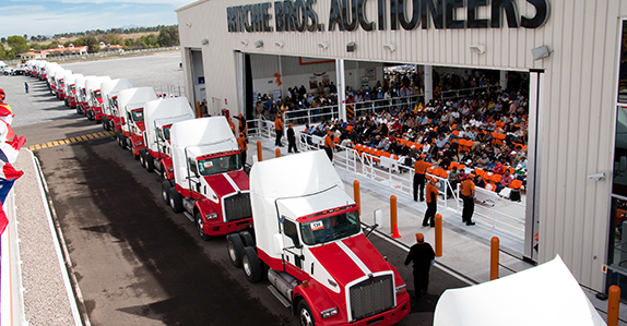 Selling trucks at a Ritchie Bros. transport truck auction.