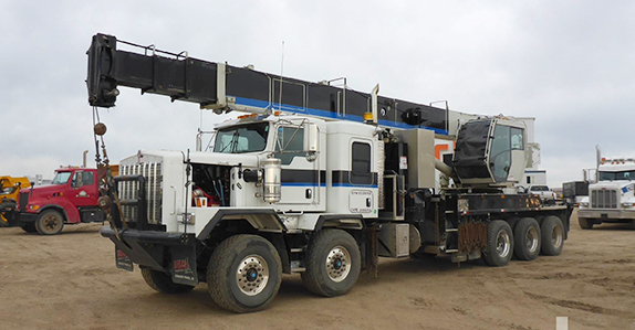 2014 Kenworth C500 T/A tri drive w/National boom truck sold in auction by Ritchie Bros.