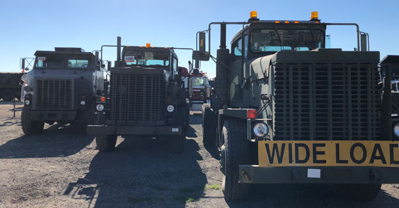 military dump trucks ready to sell at Ritchie Bros. Orlando 2018 auction