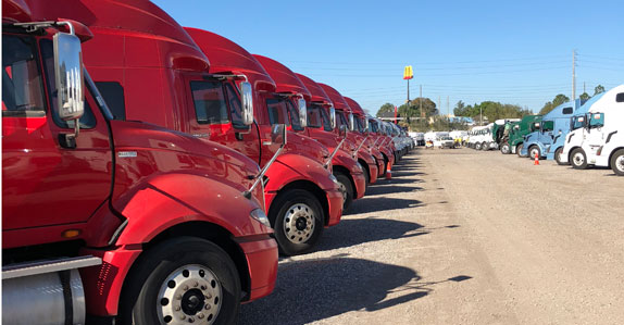 red truck tractors ready to sell at Ritchie Bros. Orlando 2018 auction
