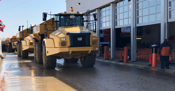 Dump trucks hitting the ramp at Ritchie Bros. Edmonton auction