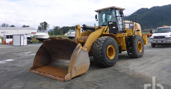 A 2014 Caterpillar 972K wheel loader sold by Ritchie Bros. Auctioneers