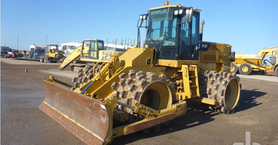 2013 Caterpillar 815F2 compactor sold by Ritchie Bros.