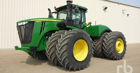 2016 John Deere 9520R 4WD tractor sold by Ritchie Bros. Auctioneers.