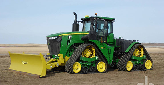 2018 John Deere 9620RX track tractor sold by Ritchie Bros. Auctioneers.