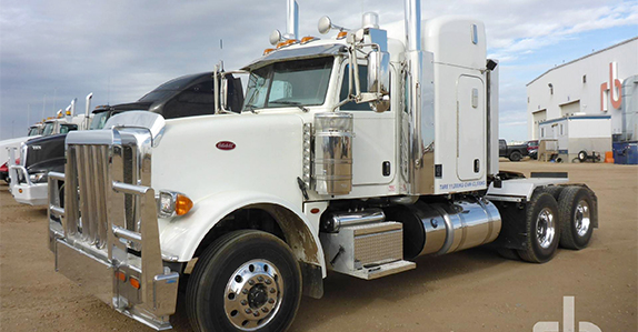 Work trucks and truck tractors sold in auction by Ritchie Bros.