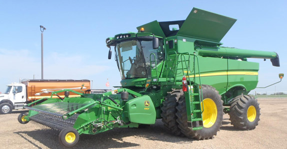 2012 John Deere S690 Combine http://www.rbauction.com/blog/top-5-biggest-ticket-agriculture-items-of-the-month-august-2012
