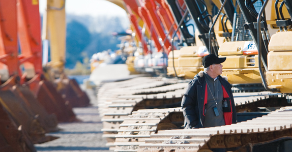 A prospective buyer inspecting an excavator