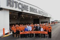 The Ritchie Bros. Geelong team is joined by local officials and friends in cutting the ribbon.