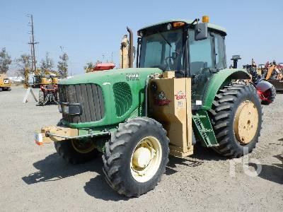2004 JOHN DEERE 6615 MFWD Tractor
