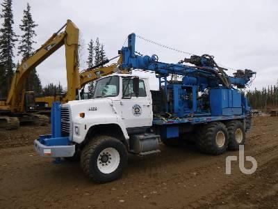 1993 FORD L8000 T/A Drill Truck