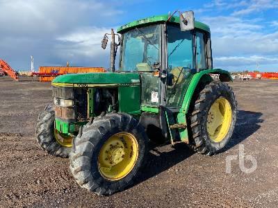 1999 JOHN DEERE 6210 MFWD Tractor