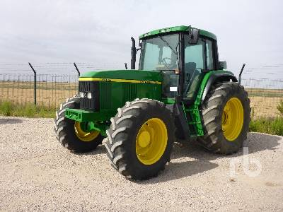 2001 JOHN DEERE 6910 MFWD Tractor